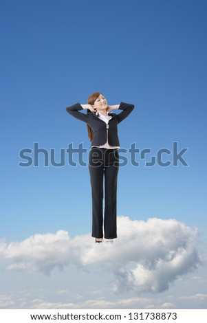 Asian business woman feel relax and stand on clouds over sky with blue copyspace.