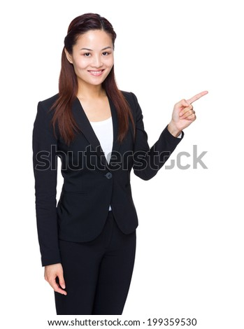 Asian business woman finger point aside