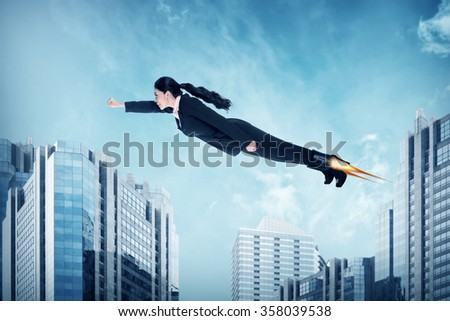 Asian business woman flying with rocket shoes. Business challenge concept