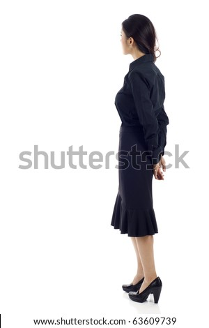 Asian business woman from the back - looking at something over a white background