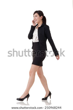 Asian business woman, full length portrait with reflection on studio white background.