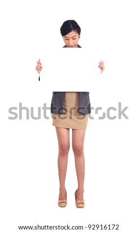 Asian business woman holding a blank billboard on white