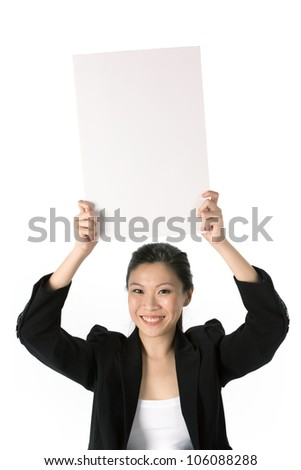 Asian Business woman holding an empty white sign above her head. - stock photo