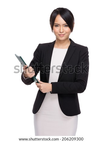 Asian business woman holding chip board on white background