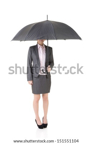 Asian business woman is holding umbrella with half hidden face under it. Isolated on the white background. - stock photo