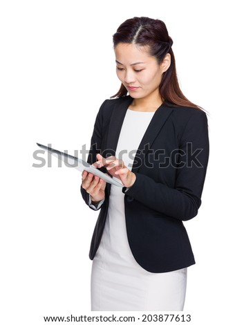 Asian business woman look at digital tablet