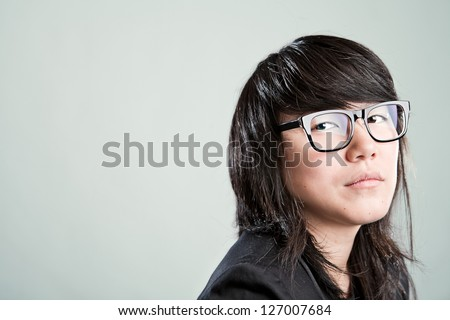 asian business woman looking at the camera