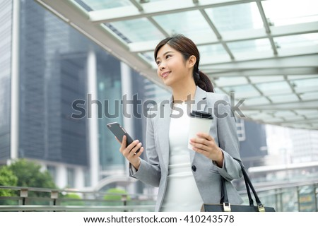 Asian business woman on the cell phone