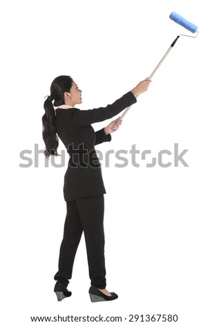 Asian business woman painting with roller isolated over white background