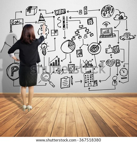 Asian Business woman point at business graph concept chart on wall background - stock photo