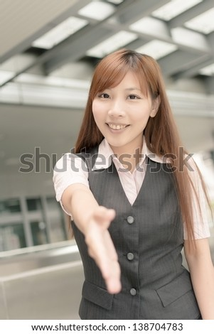 Asian business woman shake hand with you, closeup portrait in outside , Taipei, Taiwan, Asia.