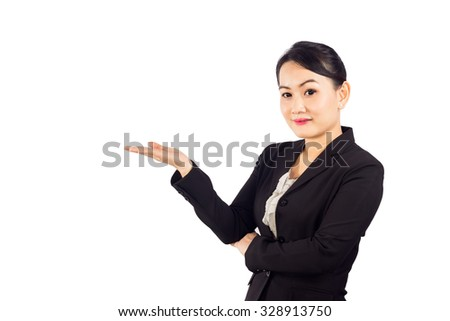 Asian business woman showing copy space up over white background, clipping path. - stock photo