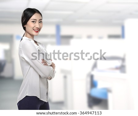Asian business woman smiling over office building background