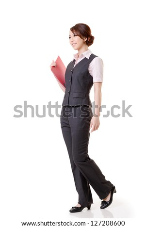 Asian business woman standing against studio white background, full length portrait. - stock photo