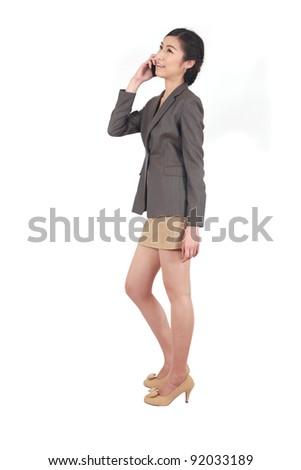 Asian Business woman talking on smart phone - stock photo