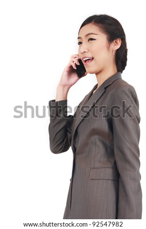 Asian Business woman talking on smart phone isolated over a white background - stock photo