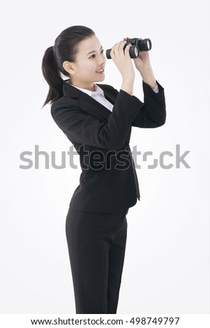 Asian business woman using a telescope