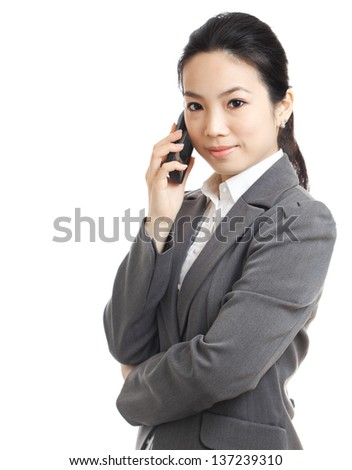 asian business woman using mobile phone - stock photo