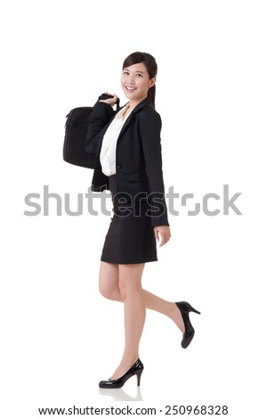 Asian business woman walking, full length portrait with reflection on studio white background.