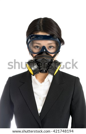 Asian business woman wearing gas mask, isolated on white background - stock photo