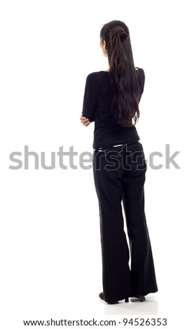 Asian business woman with arms crossed from the back - looking at something isolated over white background