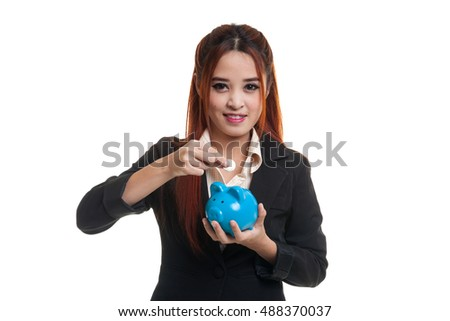 Asian business woman with coin and pig coin bank  isolated on white background.