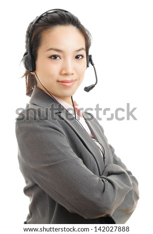 Asian business woman with headset - stock photo
