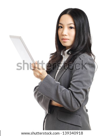 Asian business woman with tablet - stock photo