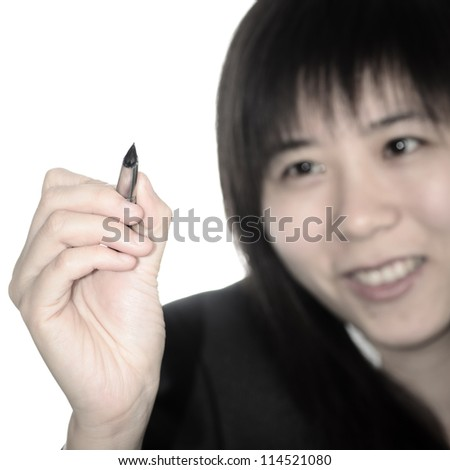 Asian business woman writing something with a pen isolated - stock photo