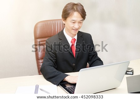 Asian businessman are working  with laptop in office.