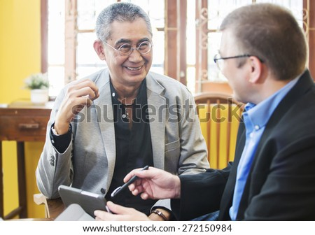 Asian businessman Discussing In office  - stock photo