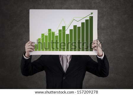 Asian businessman hiding behind the growing graph - stock photo