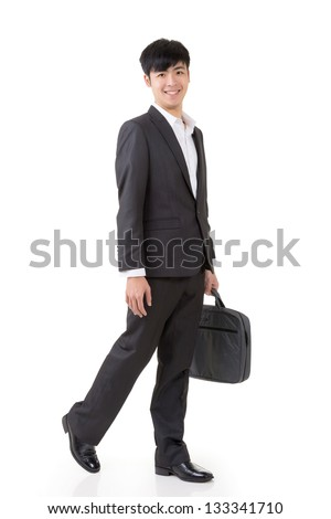 Asian businessman hold briefcase and walk, full length portrait isolated on white background. - stock photo