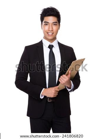 Asian Businessman hold with clipboard - stock photo