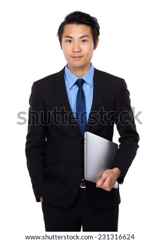 Asian Businessman hold with laptop - stock photo