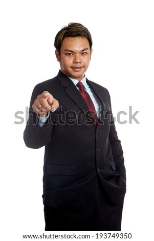 Asian businessman in suit point to camera isolated on white background