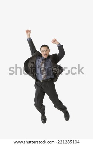 Asian businessman jumping - stock photo