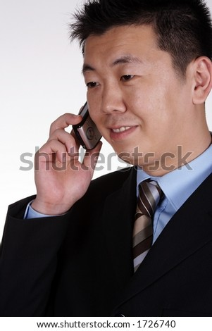 Asian businessman on the phone. - stock photo