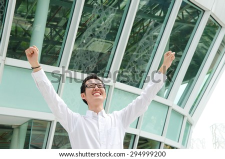 Asian businessman open his arms - stock photo