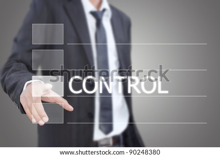 Asian businessman pushing control word on a touch screen interface. - stock photo