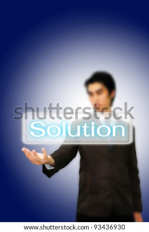 Asian businessman pushing solution word.