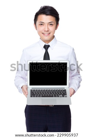Asian Businessman show with blank screen of laptop