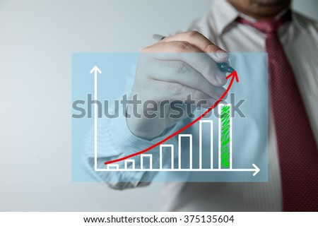 Asian businessman sketching diagram of changes of market - stock photo