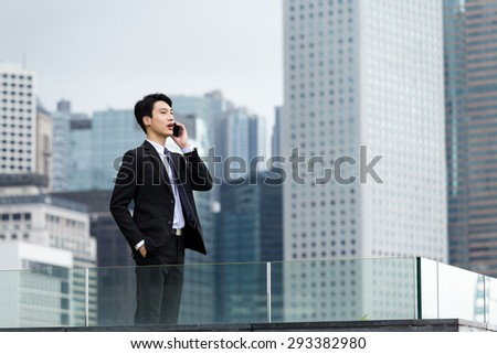 Asian businessman talk to cellphone at Hong Kong