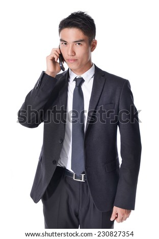 Asian businessman talking on mobile cell phone, happy smile looking up, using cellphone,