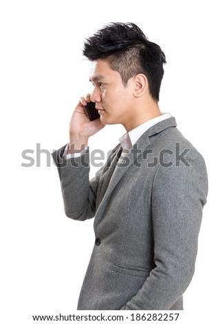 Asian businessman talking to mobile