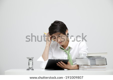 Asian businessman thinking at desk
