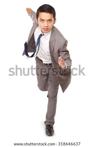 Asian businessman to run very fast, isolated on white background
