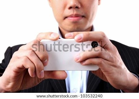 Asian businessman using a mobile camera on the white background - stock photo