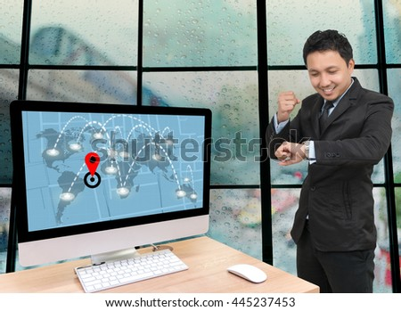 Asian Businessman using tablet with Computer set showing part of navigator map on traffic jam with Rain drop On the window Glass, Elements of this image furnished by NASA